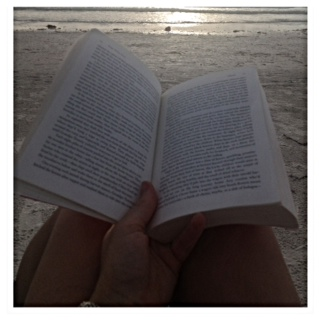 Reading on the beach at sunset. Heaven!