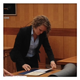I got SWORN IN yesterday! This is me signing my attorney's oath.