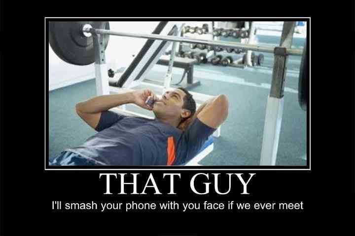 guy-on-phone-bench-press