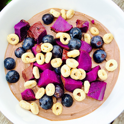 Chocolate Greek Yogurt Bowl... topped with purple sweet potatoes, blueberries, and Cheerios. It's good. I swear.