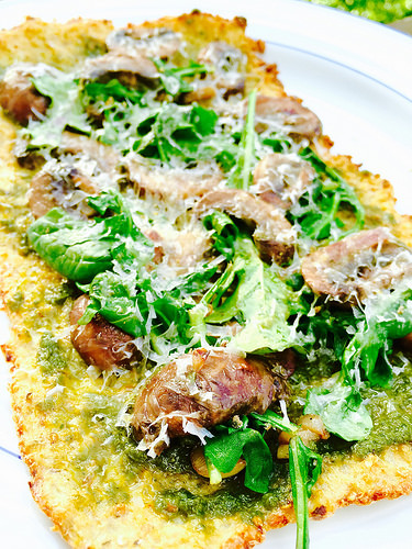 Gluten-free, Dairy-free Cauliflower Crust topped with pesto and mushrooms. Great lighter dinner for the warmer weather!