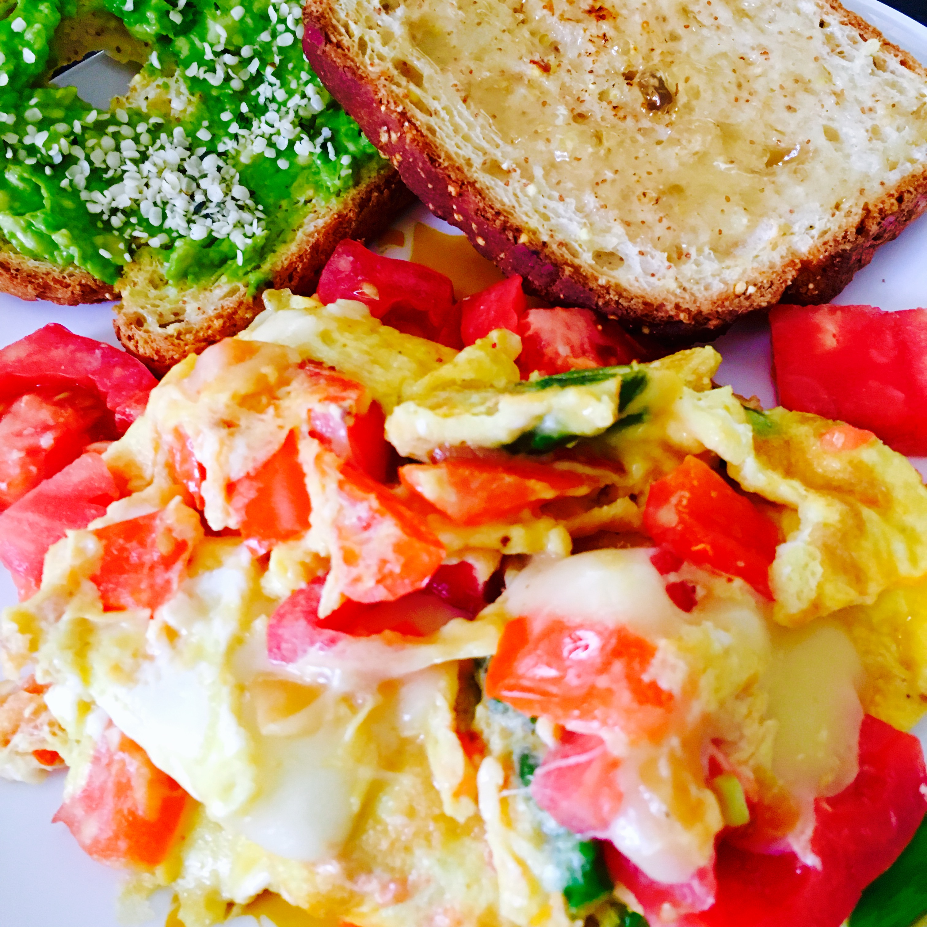 Egg scramble with smashed avocado and jelly toast