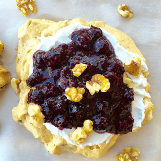 Healthy Walnut Pavlova with Blueberry Sauce and Coconut Cream