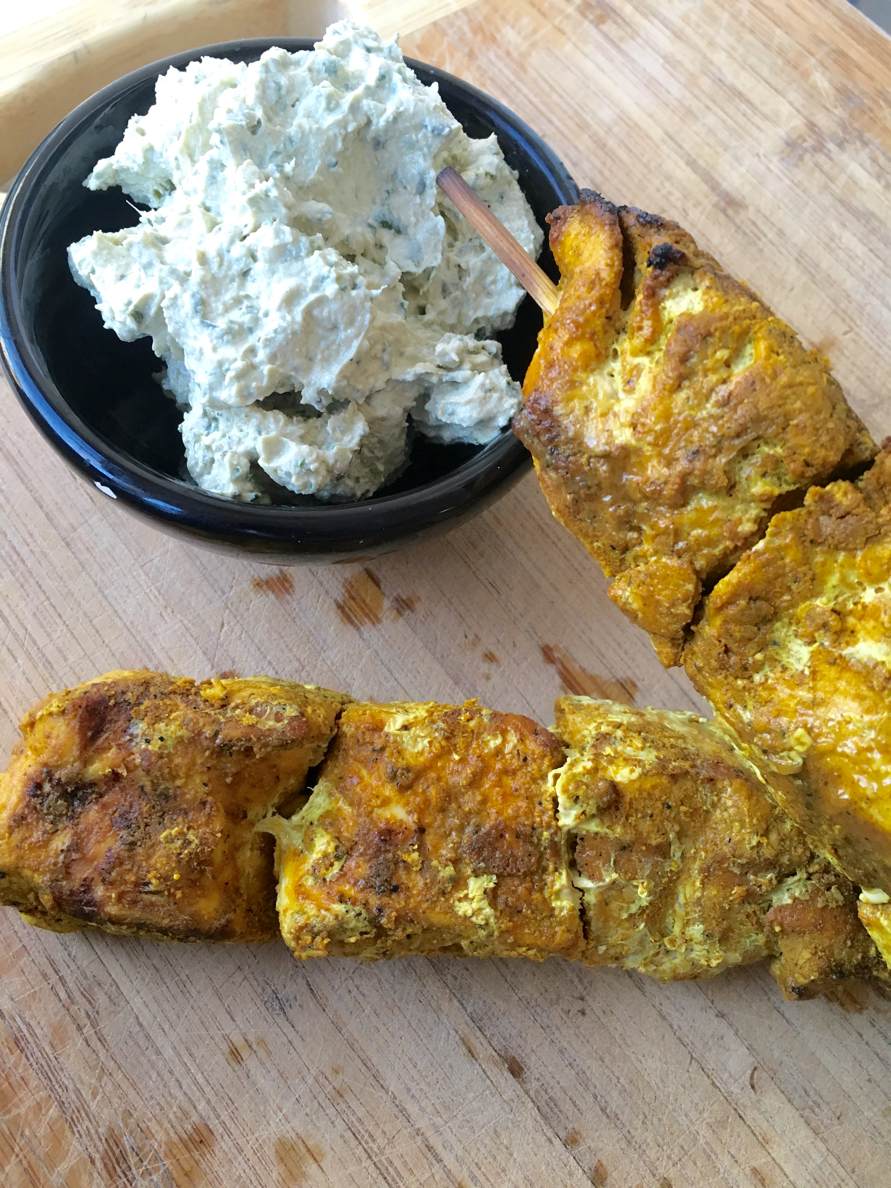 Try these flavorful Middle Eastern Spiced Chicken Skewers with Herbed Tahini Sauce on the grill this summer!