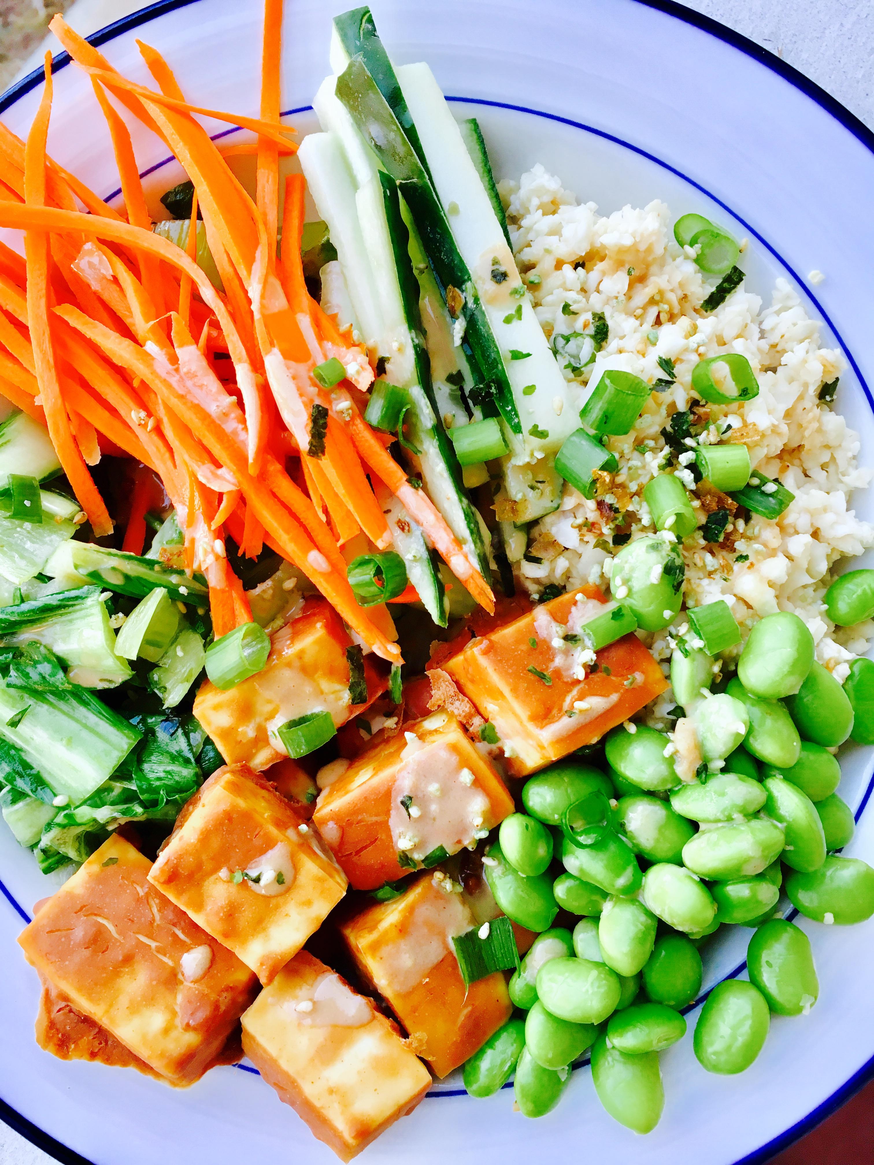 Sriracha Peanut Tofu Power Bowl with Ginger-Tahini Dressing and Cauliflower Rice